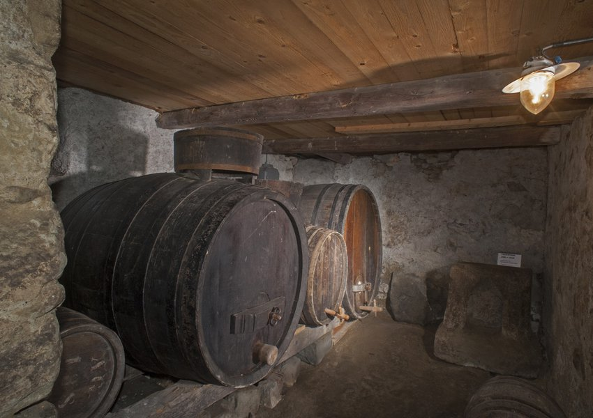 Wooden casks for must and wine, rammed earth floor; font JHS 1639