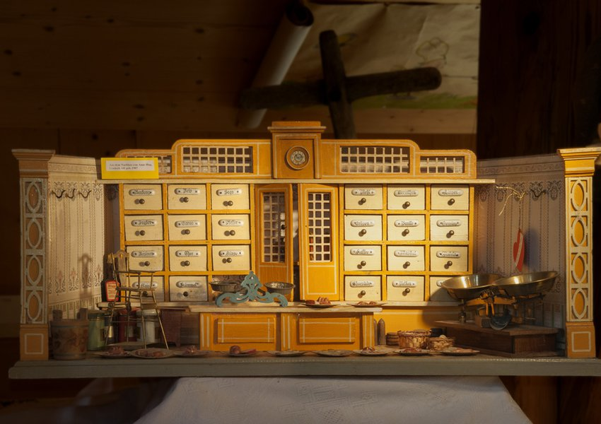 A miniature grocer's shop, from c.1900